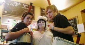Iceberg ahead! Landlady Michelle Hughes and two of her bar staff
