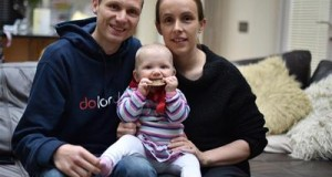 Amy, Ben and Bethany (who's taking a nibble of Ben's London Marathon medal!)