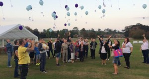 Balloons are released after the family fun day at Stone Cricket Club