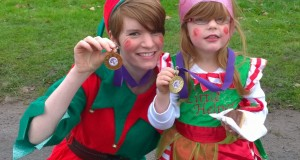Stephanie and daughter XXXX with their Elf Run medals