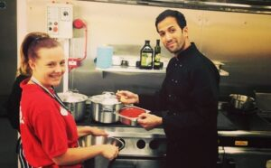 Niven Ziad in the kitchen with a student from Unity School