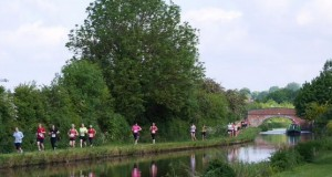 Runners on the canal towpath. Photo by Paul Newton