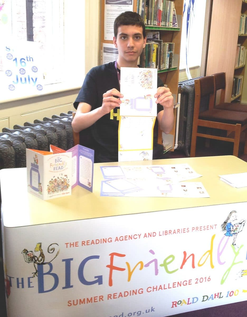 Penkridge Library volunteer 15 year-old Mikey Roberts ready to sign youngsters up for the challenge.
