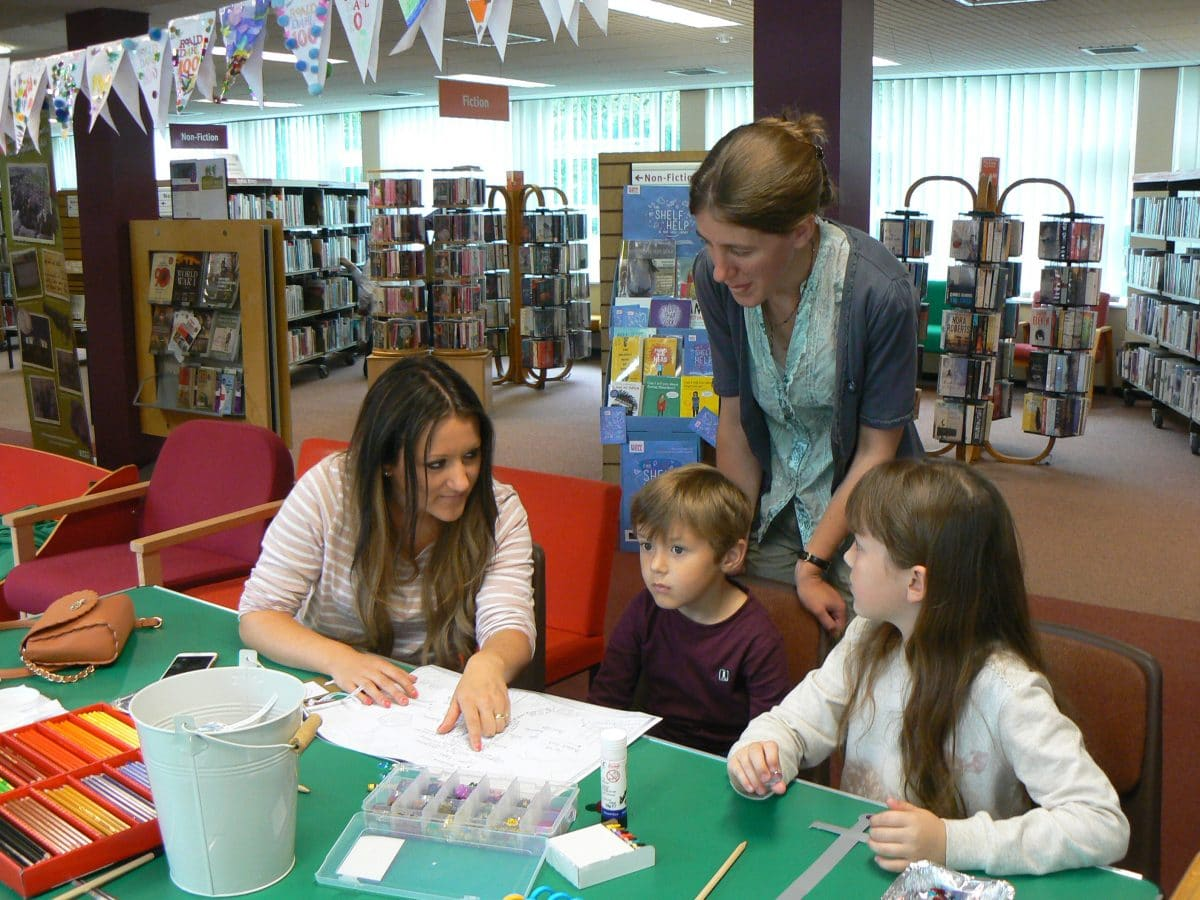 Local artist Hannah Reynolds at a Tolkien in Staffordshire Exhibition craft workshop with the Molland Family at Codsall Library